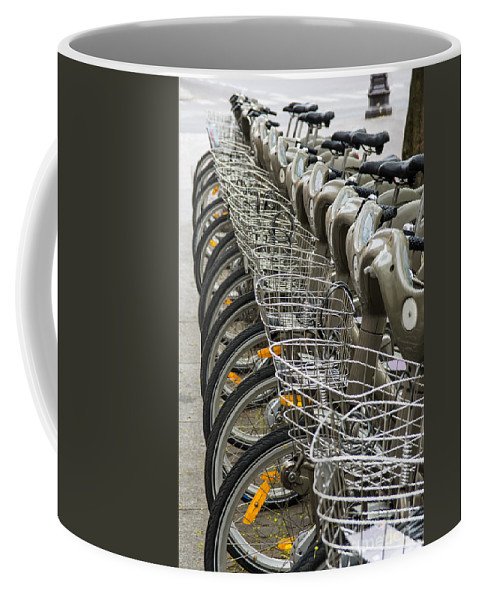 City Coffee Mug featuring the photograph Row Of Bicycles by Carlos Caetano