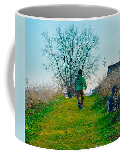 Young Coffee Mug featuring the photograph Running by John Ullrick