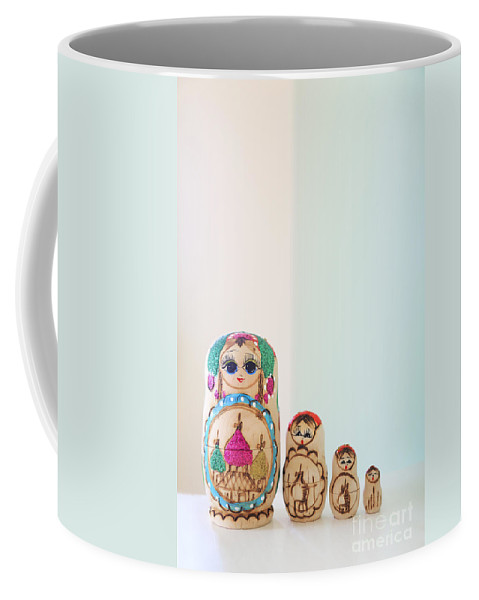 Russian Coffee Mug featuring the photograph Russian Dolls by Evelina Kremsdorf