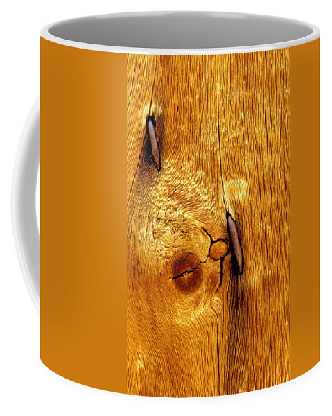 Rusted Nails Coffee Mug featuring the photograph Rusted Nails In Weathered Pine by Cyril Furlan