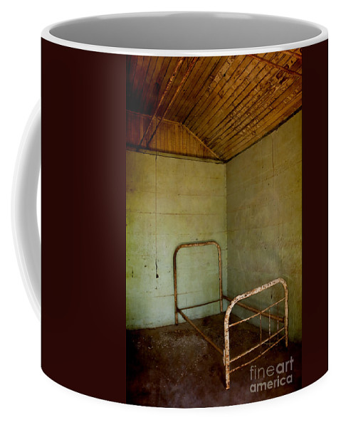 Bed; Frame; Iron; Wrought Iron; Empty; Broken; Foreboding; Desolate; Rust; Rusty; Death; Mysterious; Mystery; Eerie; Wire; Wood; Cement; Dirty; Old; Grunge; Disgusting; Vulture Mine; Arizona; Ghost Town; Interior; Inside; Indoors; Abandoned; Creepy; Danger; Dark Coffee Mug featuring the photograph Rusty Bed by Margie Hurwich