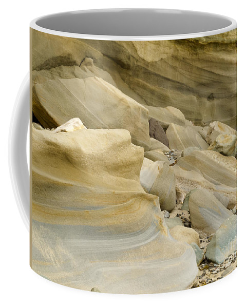 Banded Coffee Mug featuring the photograph Sandstone Sediment Smoothed And Rounded By Water by Stephan Pietzko