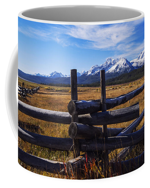 Sawtooth Mountains Coffee Mug featuring the photograph Sawtooth Mountains And Wooden Fence by Vishwanath Bhat