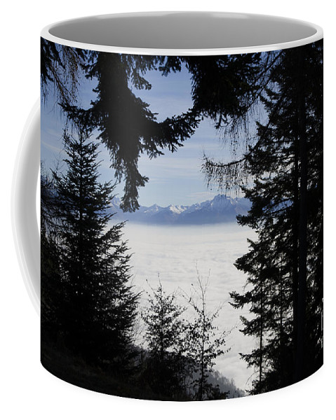 Sea Of Fog Coffee Mug featuring the photograph Sea Of Fog Over An Alpine Lake by Mats Silvan