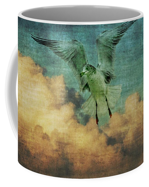 Bird Coffee Mug featuring the photograph Seagull In The Clouds by Alice Gipson