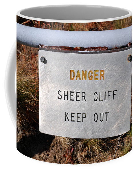 Warning Sign Coffee Mug featuring the photograph Sheer Cliff Warning Sign by Connie Fox