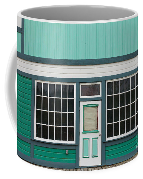 Abstract Coffee Mug featuring the photograph Small Store Front Entrance To Green Wooden House by Stephan Pietzko