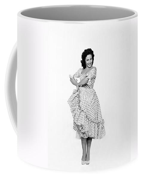 1957 Coffee Mug featuring the photograph Spanish Star Carmen Sevilla. by Underwood Archives