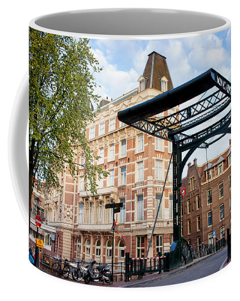 Amsterdam Coffee Mug featuring the photograph Staalstraat Bridge On Kloveniersburgwal Canal In Amsterdam by Artur Bogacki