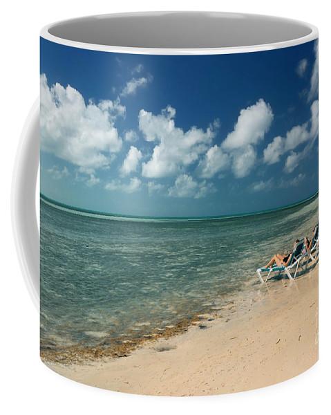 Bahamas Coffee Mug featuring the photograph Sunbathers On The Beach by Amy Cicconi