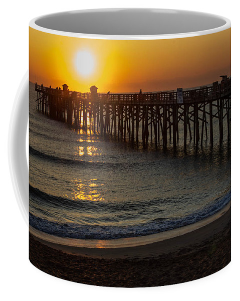 Sunrise Coffee Mug featuring the photograph Sunrise by Tyson Kinnison