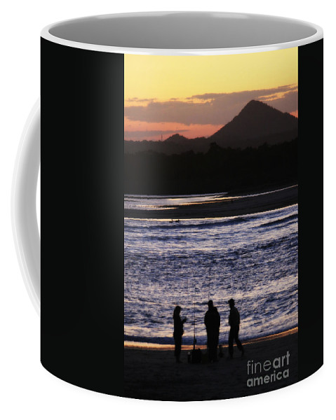 Beach Coffee Mug featuring the photograph Sunset Fishing by Alanna DPhoto