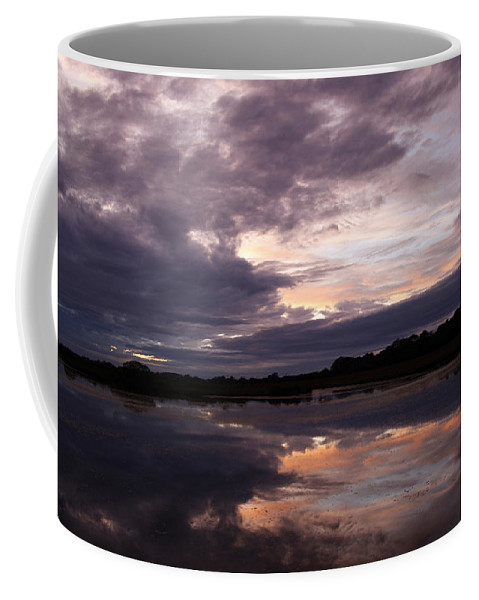 Sunset Coffee Mug featuring the photograph Sunset Reflected In A Lake by Steve Ball