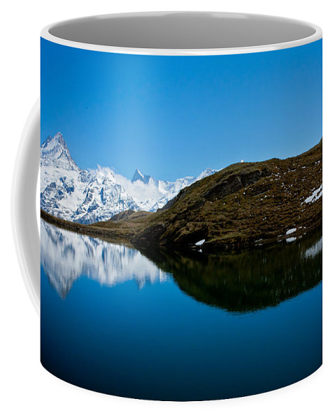 Alps Coffee Mug featuring the photograph Swiss Alps - Schreckhorn Reflection by Anthony Doudt