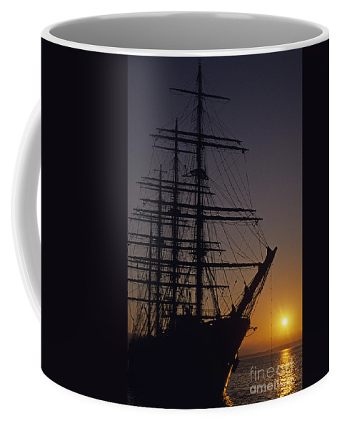 Travel Coffee Mug featuring the photograph Tall Ship Silhouetted by Jim Corwin