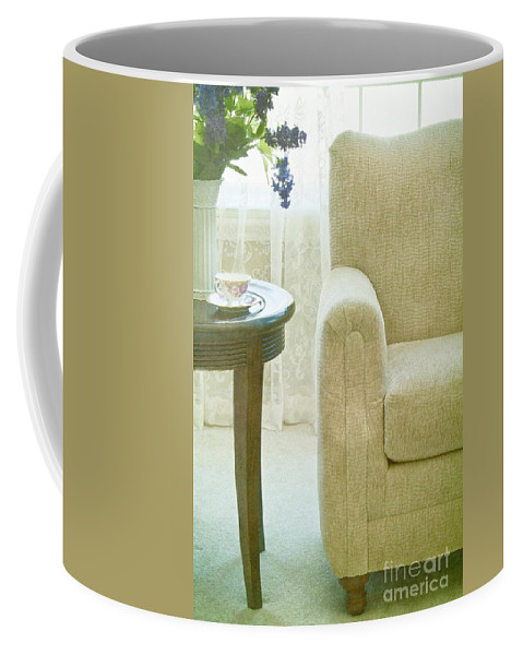 Chair; Curve; Interior; Still Life; Living Room; Sitting Room; Casual; Indoors; Room; Furniture; Nobody; Empty; Curtains; Drapes; Lace; Flowers; Vase; Lilacs; Cup; Saucer; Teacup; Drink; Table; Carpet; Comfort; Window Coffee Mug featuring the photograph Tea Time by Margie Hurwich