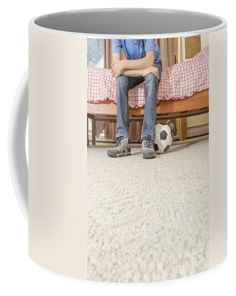 Bedroom Coffee Mug featuring the photograph Teen Boy In Bedroom by Edward Fielding