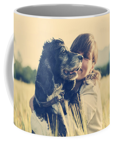 Woman Coffee Mug featuring the photograph Tenderness by Mats Silvan