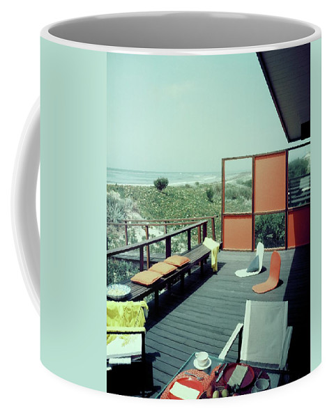 Architecture Coffee Mug featuring the photograph The Deck Of A Beach House by George De Gennaro