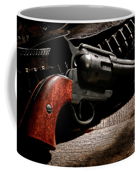 Revolver Coffee Mug featuring the photograph The Gun That Won The West by Olivier Le Queinec