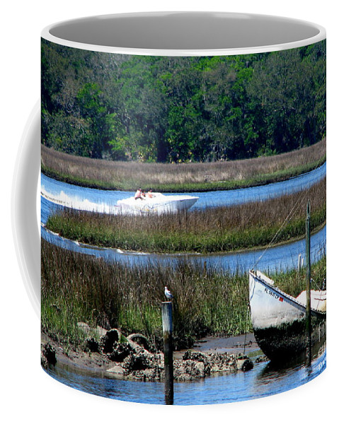 Art For The Wall...patzer Photography Coffee Mug featuring the photograph The Leak by Greg Patzer