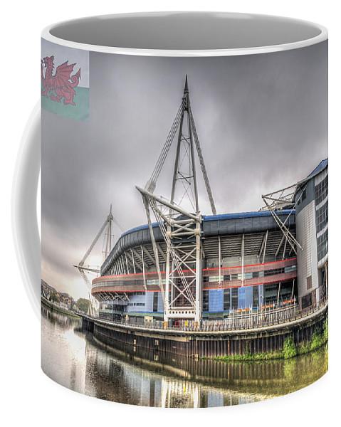The Millennium Stadium Coffee Mug featuring the photograph The Millennium Stadium With Flag by Steve Purnell