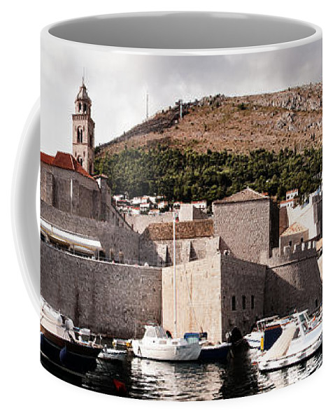 Harbor Coffee Mug featuring the photograph The Old Port Under The Ramparts by Weston Westmoreland