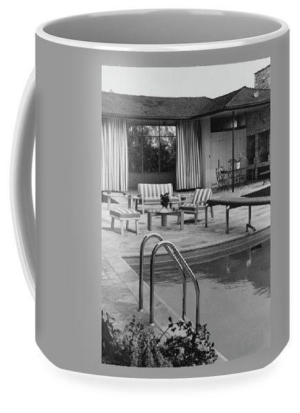 Architecture Coffee Mug featuring the photograph The Pool And Pavilion Of A House by Sharland