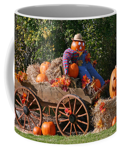 Pumpkin Coffee Mug featuring the photograph The Pumpkin Farmer by Hugh Carino