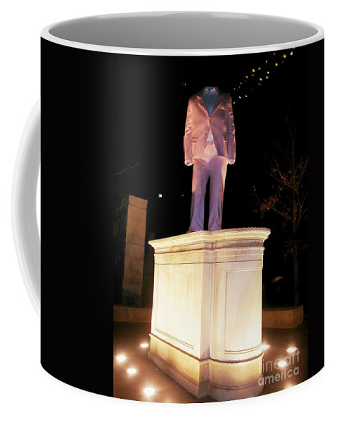 Coffee Mug featuring the photograph The Suit At City Garden by Kelly Awad