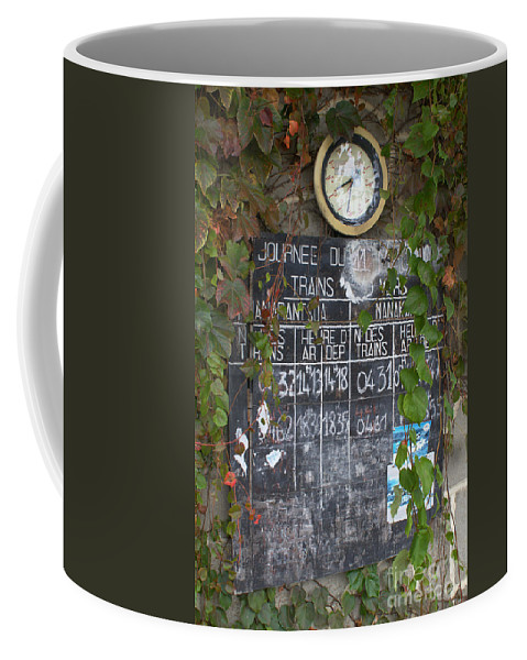 Madagascar Coffee Mug featuring the photograph timetable from a Madagascan train station by Rudi Prott