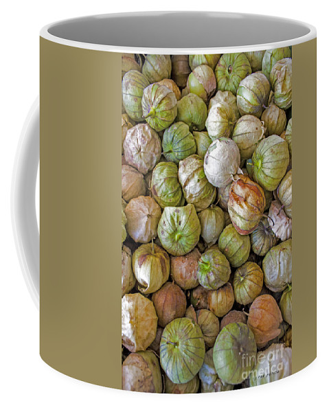Tomatillo Coffee Mug featuring the photograph Tomatillos At The Local Market by Janice Pariza