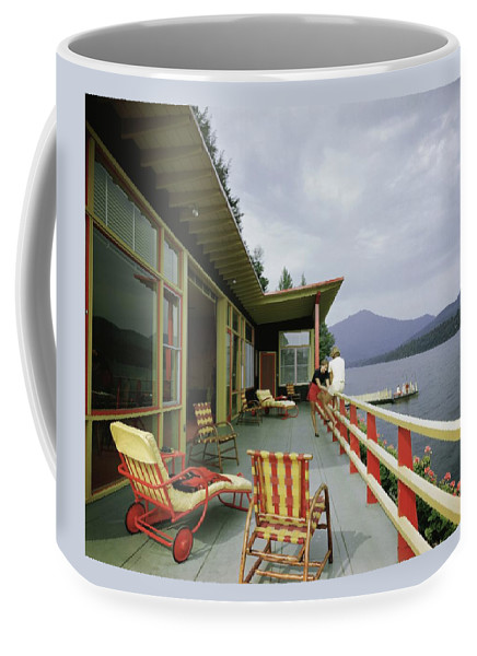 Alfred Rose Coffee Mug featuring the photograph Two Women On The Deck Of A House On A Lake by Robert M. Damora