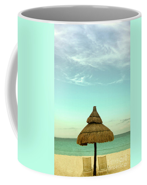 Beach; Serene; Secluded; Relax; Relaxation; Sunny; Tropic; Tropical; Vacation; Resort; No One; Empty; Clouds; Sky; Water; Sand; Ocean; Lake; Sea; Hut; Straw; Cover; Chairs; Lounge; Lovely; Beautiful Coffee Mug featuring the photograph Under The Umbrella by Margie Hurwich