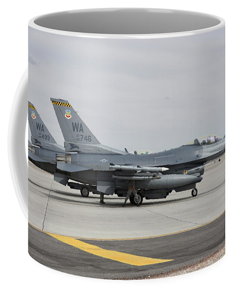 Nellis Air Force Base Coffee Mug featuring the photograph U.s. Air Force F-16c Planes Undergo by Riccardo Niccoli
