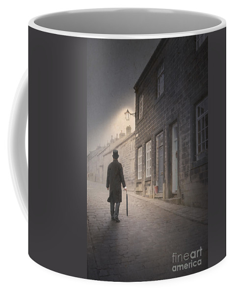 Man Coffee Mug featuring the photograph Victorian Man On A Cobbled Street by Lee Avison