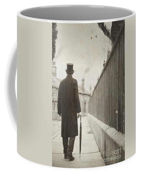 Victorian Coffee Mug featuring the photograph Victorian Man Walking Towards A Row Of Cottages by Lee Avison