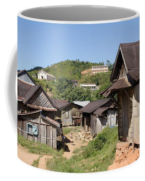 Madagascar Coffee Mug featuring the photograph village in Madagascar by Rudi Prott