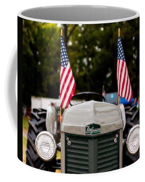 Ferguson Coffee Mug featuring the photograph Vintage Ferguson Tractor With American Flags by Jon Woodhams