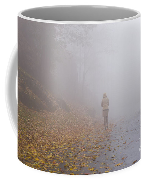 Woman Coffee Mug featuring the photograph Walking On A Foggy Road by Mats Silvan