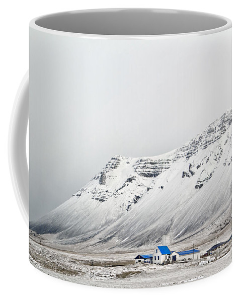Iceland Coffee Mug featuring the photograph What Lies Beneath by Evelina Kremsdorf