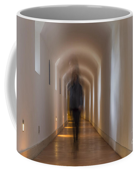 Corridor Coffee Mug featuring the photograph Woman In A Tunnel by Mats Silvan