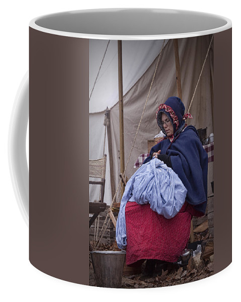 Civil War Coffee Mug featuring the photograph Woman Reenactor Sewing In A Civil War Camp by Randall Nyhof
