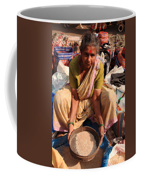 Clothes Coffee Mug featuring the photograph Woman Sifting In A Street Market India by Deborah Benbrook