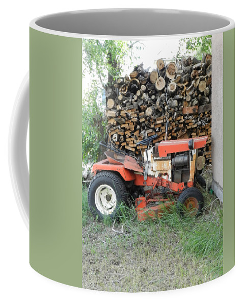 Wood Pile Coffee Mug featuring the photograph Wood Pile And Lawn Tractor by Cathy Anderson