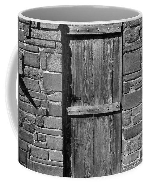Black And White Coffee Mug featuring the photograph Wooden Door And Stone Wall 1 by Denise Mazzocco