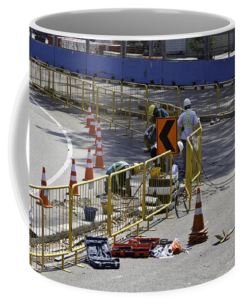 Action Coffee Mug featuring the photograph Workers Working On The Road Surface Preparing It For The Formula One Race by Ashish Agarwal