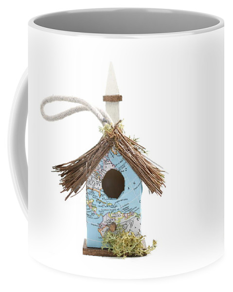 Birdhouse Coffee Mug featuring the photograph World Map Birdhouse by Henrik Lehnerer