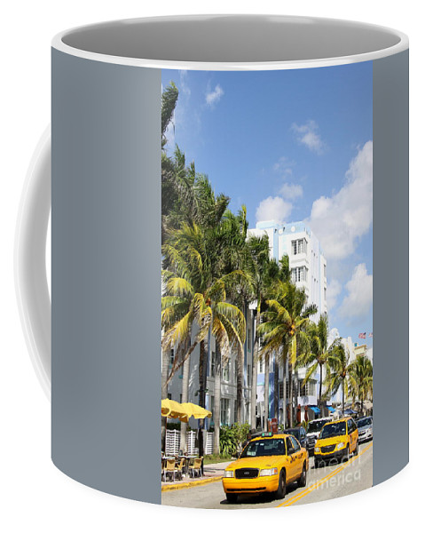 Miami Coffee Mug featuring the photograph Yellow Cabs On Ocean Drive by Christiane Schulze Art And Photography
