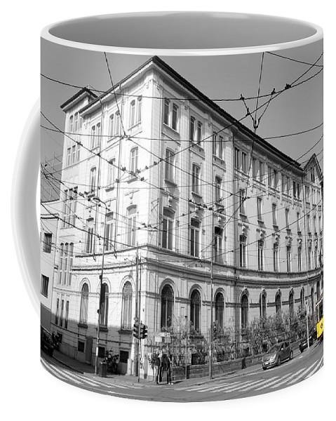 Yellow Coffee Mug featuring the photograph Yellow Tram by Valentino Visentini
